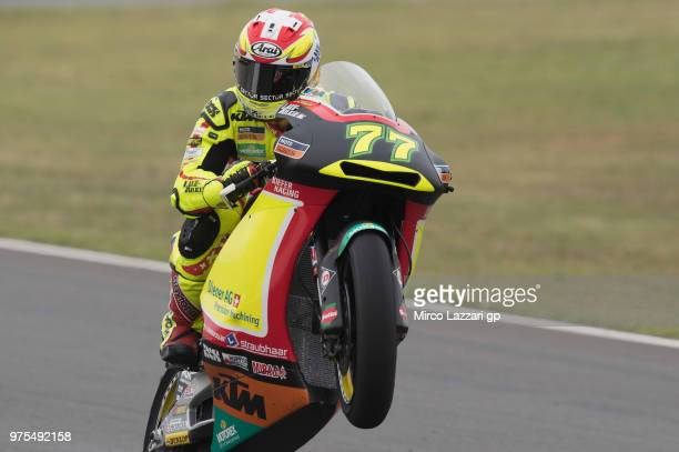 Dominique Aegerter of Swiss and Kiefer Racing lifts the front wheel during the MotoGp of Catalunya Free Practice at Circuit de Catalunya on June 15...
