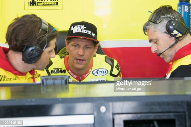 Dominique Aegerter of Swiss and Kiefer Racing speaks with mechanic in pit during the MotoGp Of Great Britain Free Practice at Silverstone Circuit on...