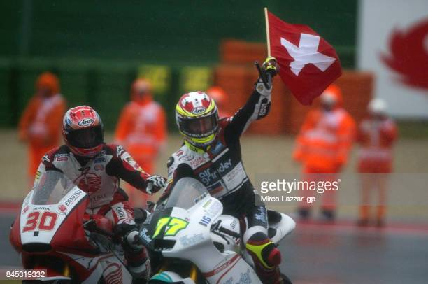 Dominique Aegerter of Switzerland and Kiefer Racing celebrates the victory with the flag at the end of the Moto2 Race during the MotoGP of San Marino...