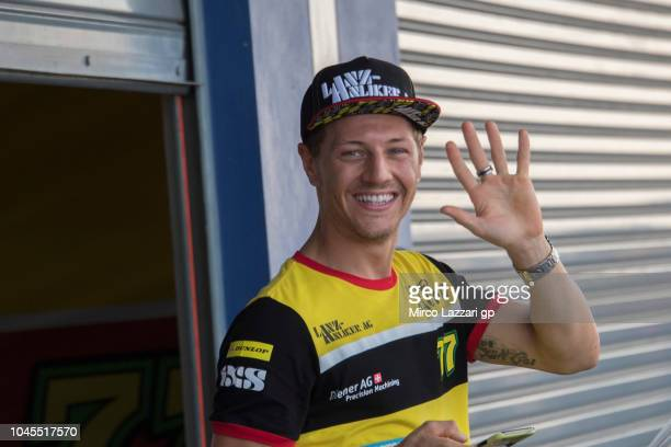 Dominique Aegerter of Switzerland and Kiefer Racing greets in paddock during the MotoGP Of Thailand Previews on October 4 2018 in Buri Ram Thailand