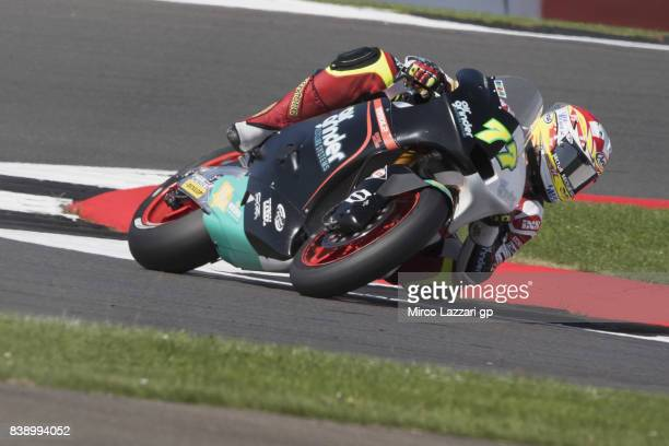 Dominique Aegerter of Switzerland and Kiefer Racing reounds the bend during the MotoGp Of Great Britain Free Practice at Silverstone Circuit on...
