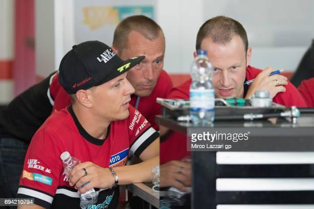 Dominique Aegerter of Switzerland and Kiefer Racing speaks in box with mechanics during the MotoGp of Catalunya Free Practice at Circuit de Catalunya...