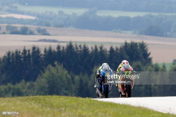 Dominique Aegerter of Switzerland and Kiefer Racing Team and Andrea Locatelli of Italy and Italtrans Racing Team rides in free practice during the...