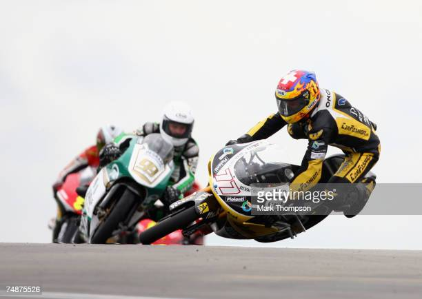 Dominique Aegerter of Switzerland and team Multimedia racing crashes out of the 125cc race at the Nickel Dime British Moto GP at Donington Park on...