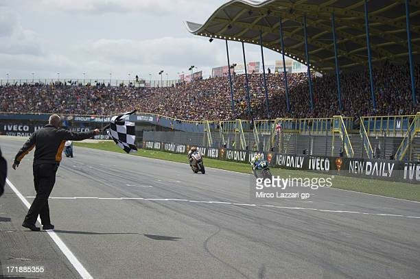 Dominique Aegerter of Switzerland and Technomag CarXpert cuts the finish lane at the end of the Moto2 race during the MotoGp Of Holland Race at TT...