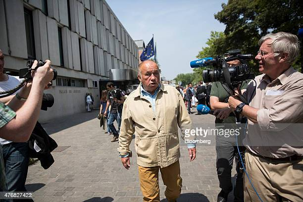 Dominique Alderweireld who runs a chain of massage parlors and is also known as Dodo La Saumure speaks to members of the media as he leaves the...