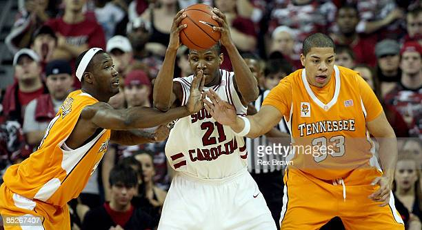 Dominique Archie of the South Carolina Gamecocks battles in the low post against Wayne Chism and Brian Williams of the Tennessee Volunteers at...