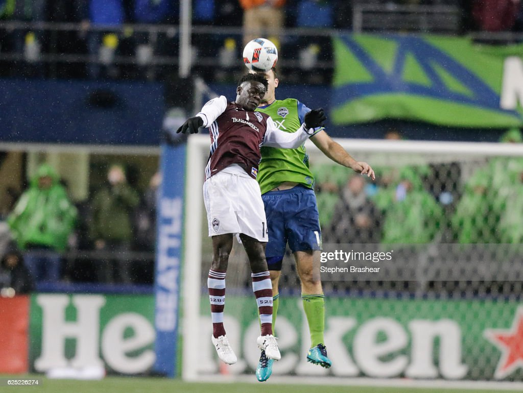 Dominique Badji #14, left, of the Colorado Rapids and Chad Marshall #14 of the Seattle Sounders goes up for a header during the second half of a match in the first leg of the Western Conference Finals at CenturyLink Field on November 22, 2016 in Seattle, Washington. The Sounders won the match 2-1.