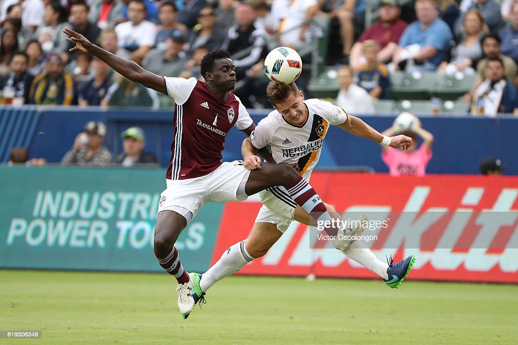 Dominique Badji #14 of Colorado Rapids and Robbie Rogers #14 of Los Angeles Galaxy vie or the ball during leg one of the Audi 2016 MLS Cup Playoff Western Conference Semfinal between the Colorado Rapids and the Los Angeles Galaxy at StubHub Center on October 30, 2016 in Carson, California.