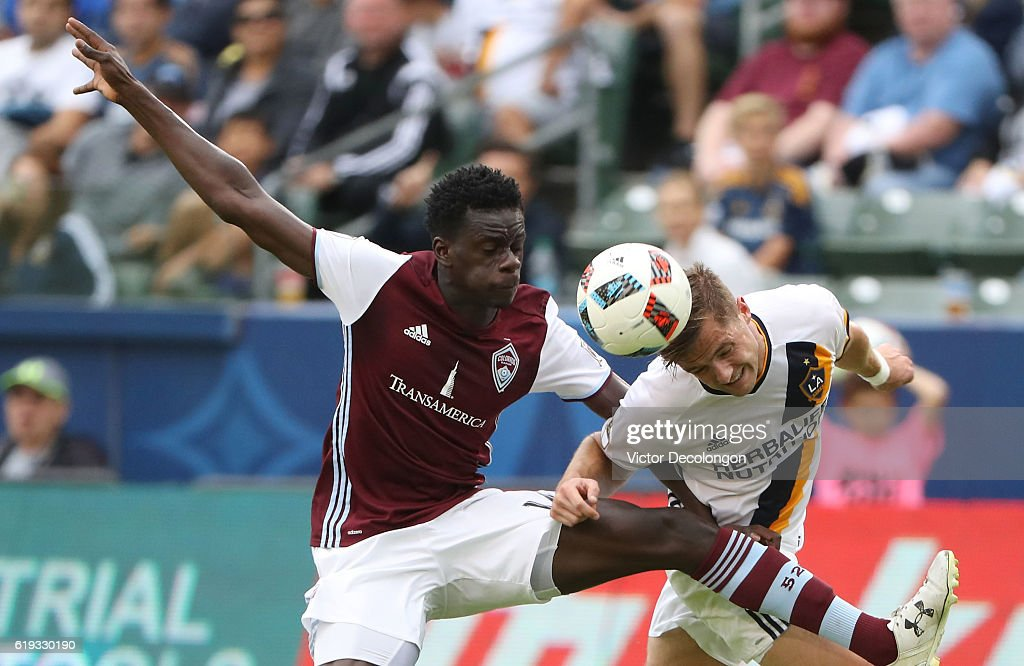 Dominique Badji #14 of Colorado Rapids and Robbie Rogers #14 of Los Angeles Galaxy vie or the ball during the first half of leg one of the Audi 2016 MLS Cup Playoff Western Conference Semfinal between the Colorado Rapids and the Los Angeles Galaxy at StubHub Center on October 30, 2016 in Carson, California. The Galaxy defeated the Rapids 1-0 in leg one of the two game playoff Western Conference Semifinal series.