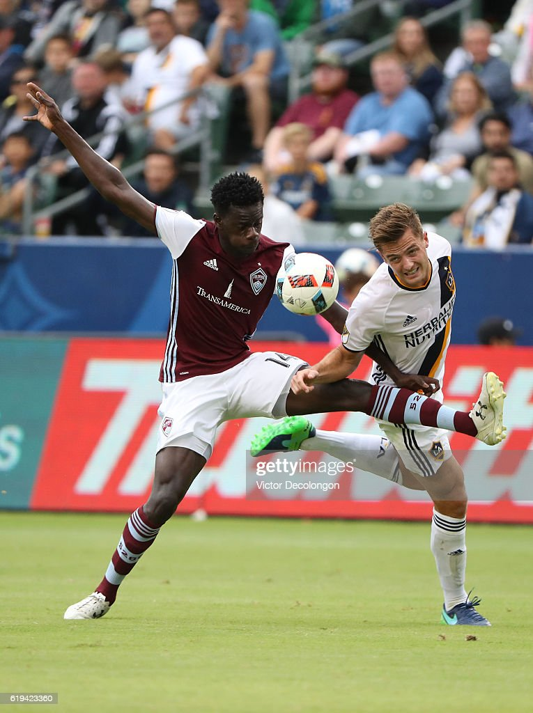 Dominique Badji #14 of the Colorado Rapids and Robbie Rogers #14 of the Los Angeles Galaxy vie or the ball during the first half of leg one of the Audi 2016 MLS Cup Playoff Western Conference Semfinal between the Colorado Rapids and the Los Angeles Galaxy at StubHub Center on October 30, 2016 in Carson, California. The Galaxy defeated the Rapids 1-0 in leg one of the two game playoff Western Conference Semifinal series.