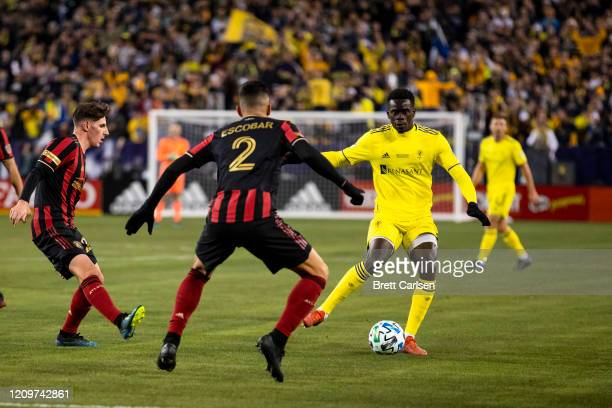 Dominique Badji of the Nashville SC moves with the ball against Franco Escobar of the Atlanta United during the first half at Nissan Stadium on...
