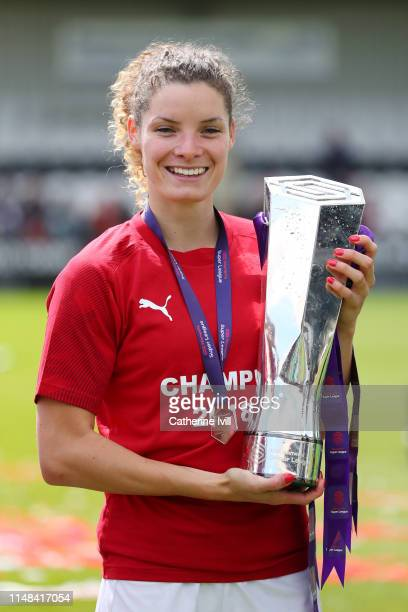 Dominique Bloodworth of Arsenal poses with the Women's Super League trophy after the WSL match between Arsenal Women and Manchester City Women at...