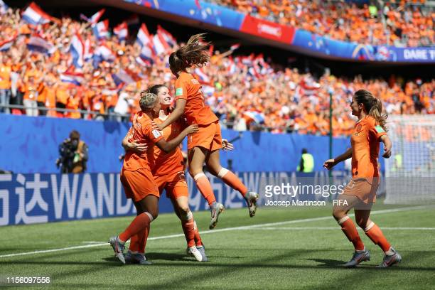 Dominique Bloodworth of the Netherlands celebrates with teammates after scoring her team's second goal during the 2019 FIFA Women's World Cup France...