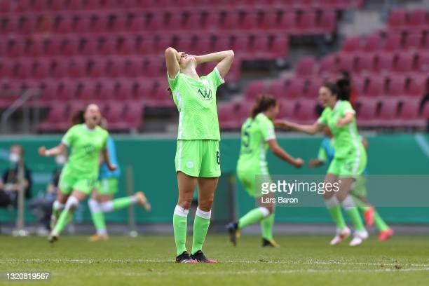 Dominique Bloodworth-Janssen of VfL Wolfsburg celebrates their side's victory after the Women's DFB Cup Final match between Eintracht Frankfurt and...