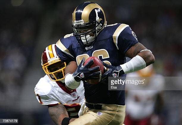 Dominique Byrd of the St Louis Rams makes the catch and runs the ball in for a touchdown in the second quarter as Sean Taylor of the Washington...