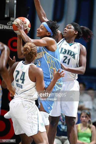 Dominique Canty of the Chicago Sky looks to pass against Charde Houston and Nicky Anosike of the Minnesota Lynx during the game on May 29 2010 at the...