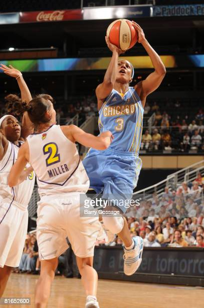 Dominique Canty of the Chicago Sky shoots against Kelly Miller of the Phoenix Mercury on June 20 at U.S. Airways Center in Phoenix, Arizona. NOTE TO...