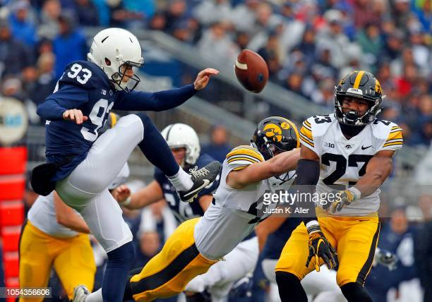 Dominique Dafney of the Iowa Hawkeyes blocks the punt of Blake Gillikin of the Penn State Nittany Lions on October 27, 2018 at Beaver Stadium in...