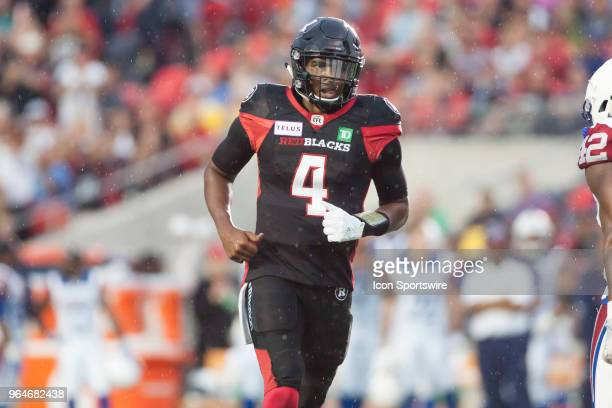 Dominique Davis of the Ottawa Redblacks runs up field against the Montreal Alouettes in Canadian Football League preseason action The Redblacks...