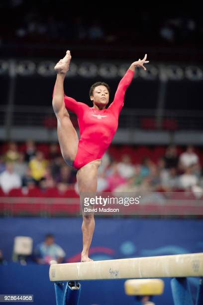 Dominique Dawes of the United States competes on the balance beam during the Women's Gymnastics event of the Olympic Games on September 16 2000 in...