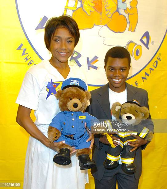 Dominique Dawes with a BuildABear Worshop Bear and Marc John Jeffries with a BuildABear Worshop Bear