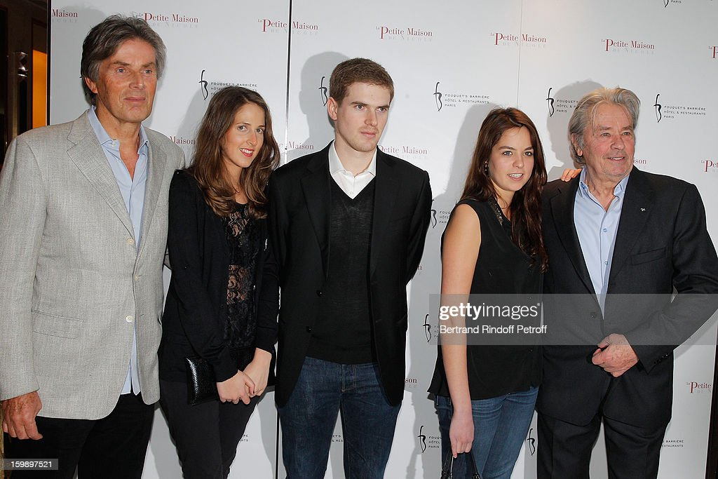 Dominique Desseigne, his children Joy and Alexandre, Anouchka Delon and her father Alain Delon attend 'La Petite Maison De Nicole' Inauguration Photocall at Hotel Fouquet's Barriere on January 22, 2013 in Paris, France.