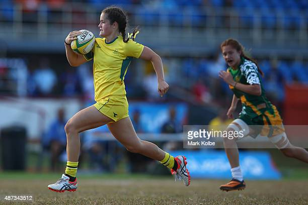 Dominique Du Toit of Australia breaks away to score a try during the girls match between Australia and the Cook Islands in the rugby sevens...