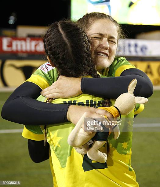 Dominique Du Toit of Australia hugs teammate Brooke Walker after the Final match against New Zealand at Fifth Third Bank Stadium on April 9 2016 in...