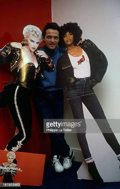 Dominique Duforest the founder of the NRJ radio in 1989 with portraits of Madonna and Whitney Houston Paris France Dominique Duforest le fondateur de...