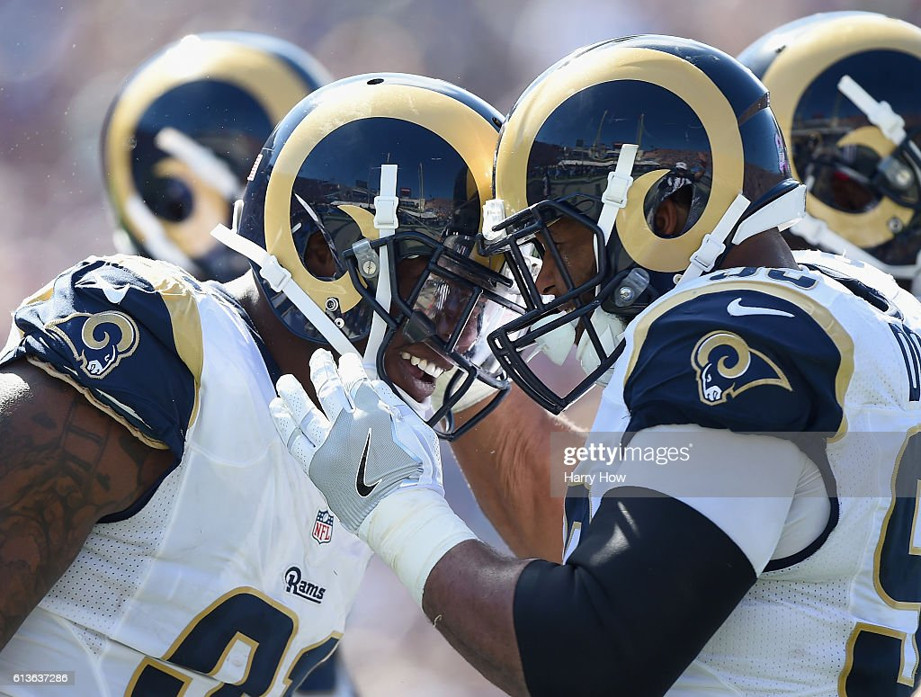 Dominique Easley #91 of the Los Angeles Rams celebrates his sack with teammate Aaron Donald #99 in the second quarter against the Buffalo Bills at the Los Angeles Memorial Coliseum on October 9, 2016 in Los Angeles, California.