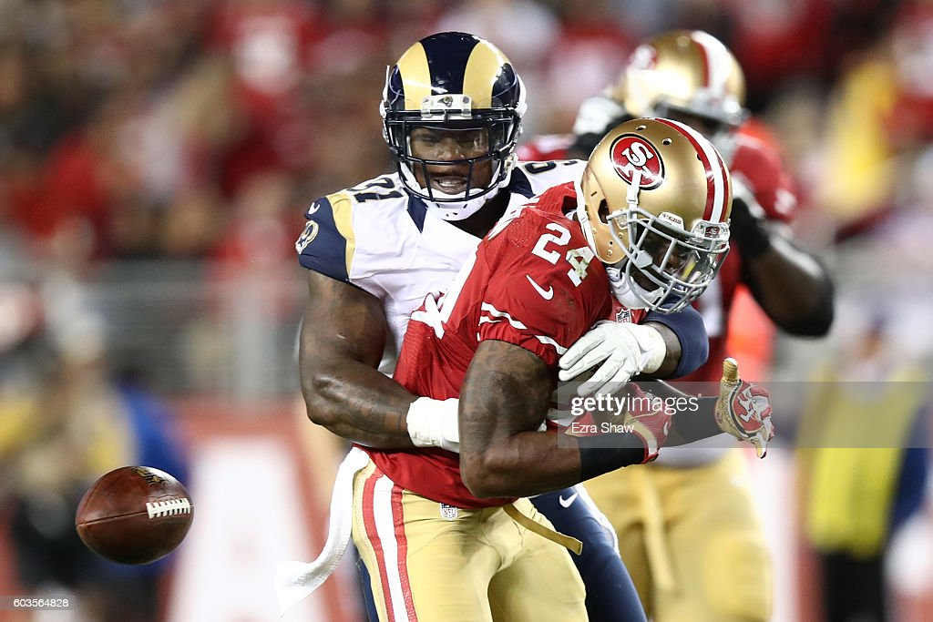 Dominique Easley #91 of the Los Angeles Rams forces a fumble by Shaun Draughn #24 of the San Francisco 49ers during their NFL game at Levi's Stadium on September 12, 2016 in Santa Clara, California.