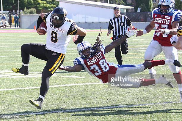 Dominique Ellis of the Montreal Alouettes misses a tackle on Jeremiah Masoli of the Hamilton TigerCats in a preseason CFL football game at Ivor Wynne...