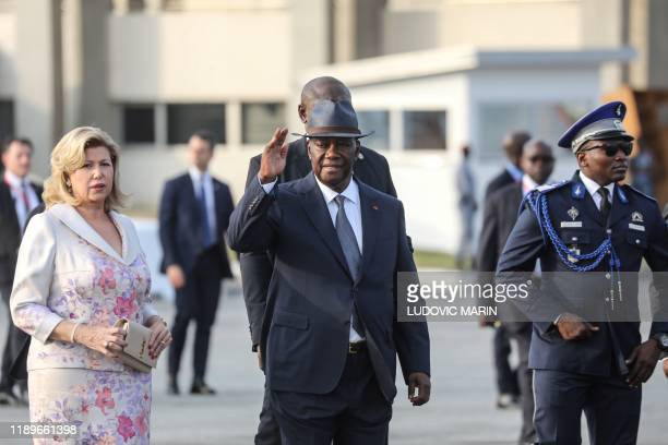 Dominique Folloroux-Ouattara and her husband Ivory Coast President Alassane Ouattara arrive to welcome the French President and his wife at the...