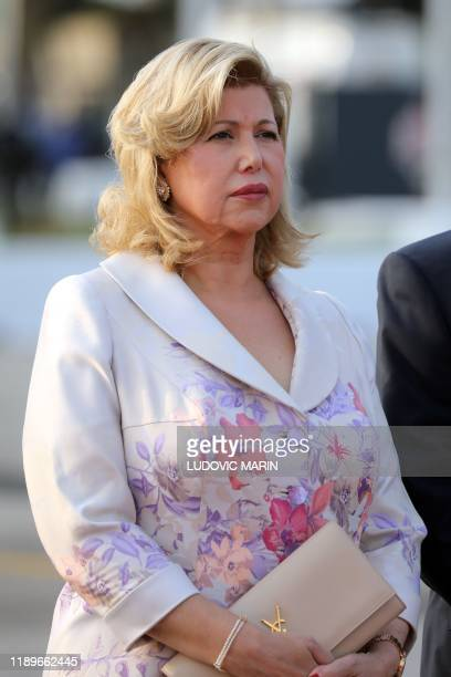 Dominique Folloroux-Ouattara, the wife of the Ivorian president, waits to welcome the French President and his wife at the Felix-Houphouet-Boigny...