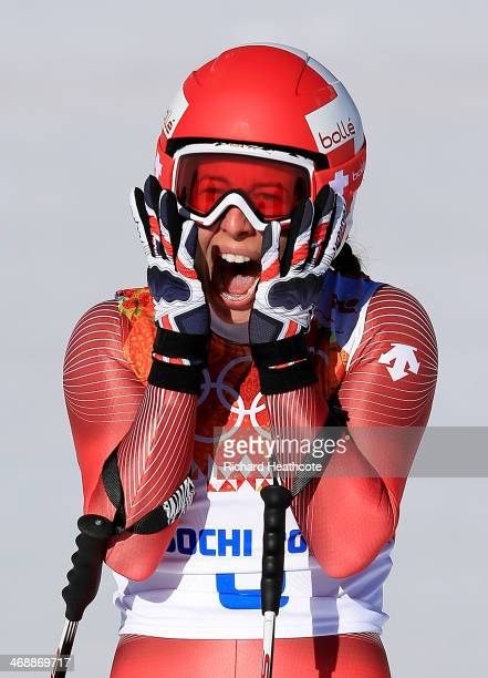 Dominique Gisin of Switzerland reacts after a run during the Alpine Skiing Women's Downhill on day 5 of the Sochi 2014 Winter Olympics at Rosa Khutor...
