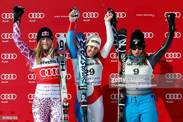 Dominique Gisin of Switzerland takes 1st place Lindsey Vonn of the USA takes 2nd place Julia Mancuso of the USA takes 3rd place during the Audi FIS...