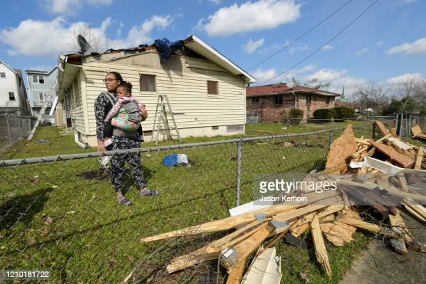 Dominique Hammond and her daughter Analise Hammond are seen outside their home in North Nashville following devastating tornadoes on March 03 2020 in...