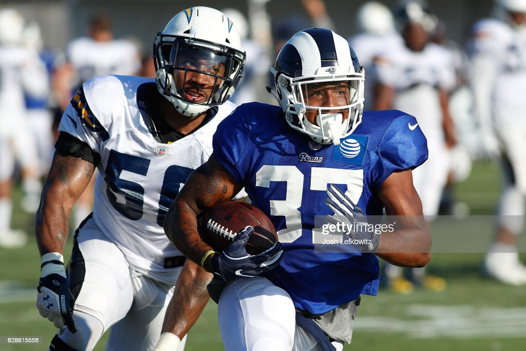 Dominique Hatfield #37 of the Los Angeles Rams runs down field against Korey Toomer #56 of the Los Angeles Chargers during a combined practice at Crawford Field on August 9, 2017 in Irvine, California.