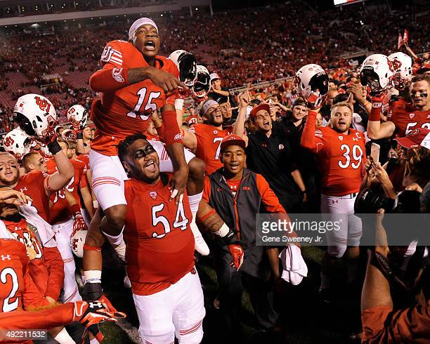Dominique Hatfield of the Utah Utes on the shoulder of teammate Isaac Asiata of the Utah Utes leads the team in celebration after their 30-24 win of...
