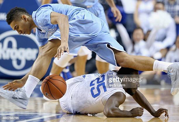 Dominique Hawkins of the Kentucky Wildcats and Maodo Lo of the Columbia Lions battle for a loose ball during the game at Rupp Arena on December 10,...