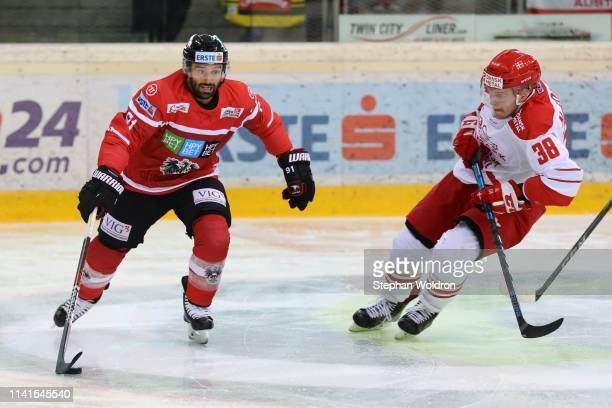Dominique Heinrich of Austria and Morten Poulsen of Denmark during the Austria v Denmark - Ice Hockey International Friendly at Erste Bank Arena on...