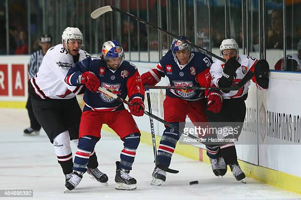 Dominique Heinrich of Salzburg and his team mate Matthias Trattnig fight with Markus Hannikainen of Jyvaskyla and his team mate Anssi Lofman during...