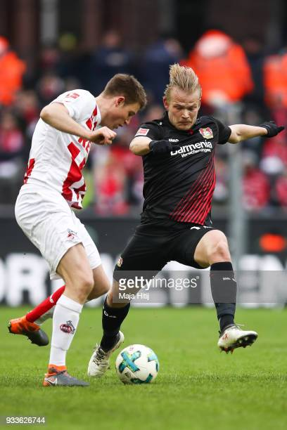 Dominique Heintz of 1FC Koeln and Joel Pohjanpalo of Bayer Leverkusenbattle for the ball during the Bundesliga match between 1 FC Koeln and Bayer 04...