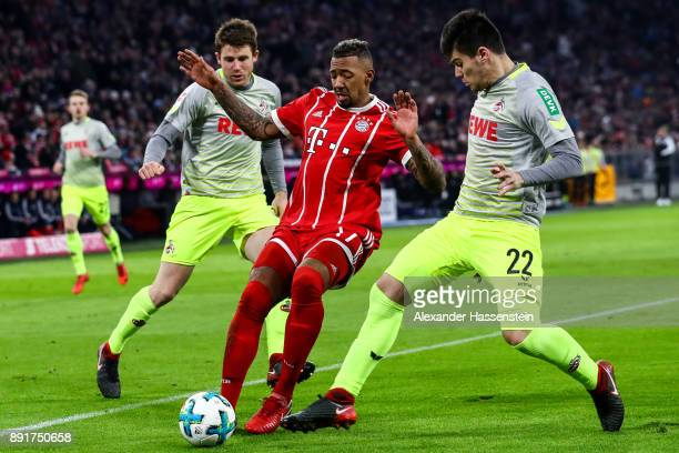 Dominique Heintz of 1FC Koeln Jerome Boateng of Bayern Munich and Jorge Mere Perez of 1FC Koeln battle for the ball during the Bundesliga match...