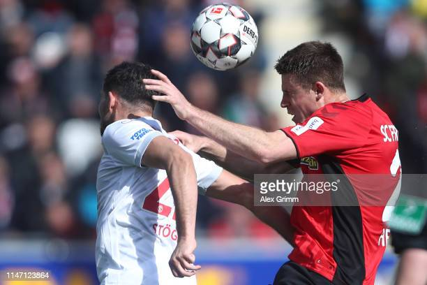 Dominique Heintz of Freiburg jumps for a header with Kevin Stoeger of Duesseldorf during the Bundesliga match between Sport-Club Freiburg and Fortuna...