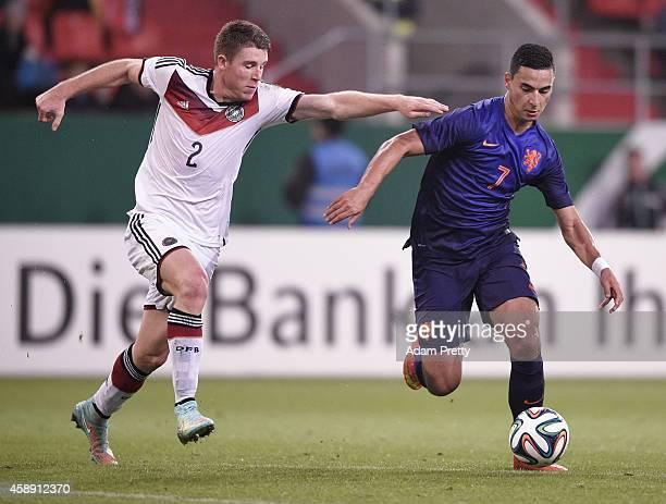 Dominique Heintz of Germany challenges Anwar El-Ghazi of the Netherlands during the U21 Germany v U21 Netherlands International Friendly match at...