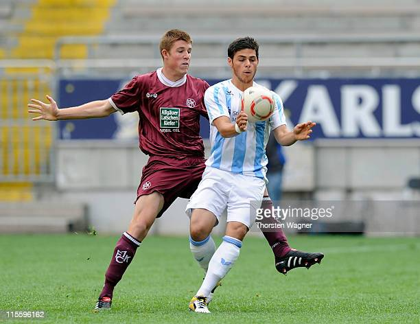 Dominique Heintz of Kaiserslautern battles for the ball with Kevin Volland of Muenchen during the A juniors semi final match between 1FC...