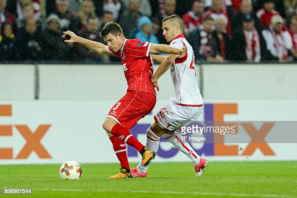 Dominique Heintz of Koeln and Aleksandar Pesic of Belgrad battle for the ball during the UEFA Europa League group H match between 1 FC Koeln and...