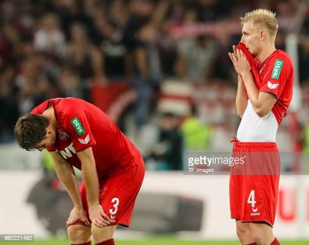 Dominique Heintz of Koeln and Frederik Hillesborg Sorensen of Koeln looks dejected during the Bundesliga match between VfB Stuttgart and 1 FC Koeln...